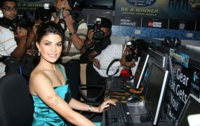 An Indian film star plays games at a press junket.