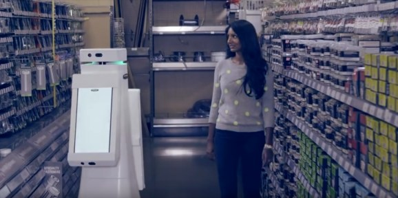 Fellows Robots' in-store OSHBot shows a customer where to find the product she's looking for.