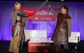 Kate Edwards of the IGDA and Dean Takahashi of GamesBeat get into the Game of Thrones theme at GamesBeat 2015.