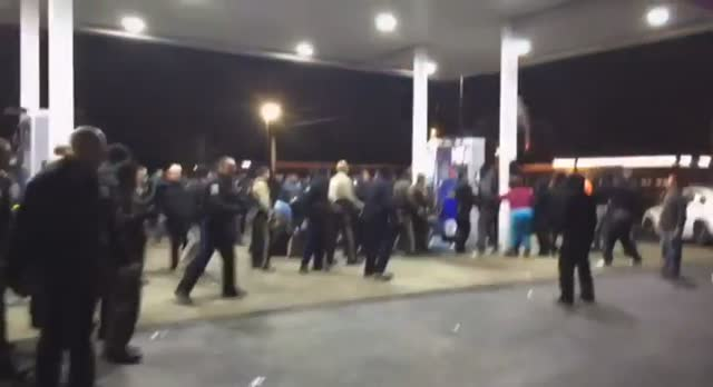 Police are seen making arrests in Berkeley, Missouri early Wednesday morning