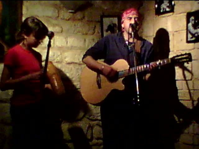 Resistencias open mic – with Roberto Arciniega on guitar and singing.