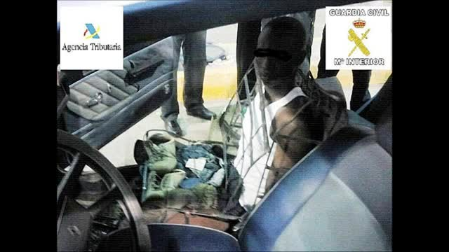 illegal-immigrant-spain-car-seat