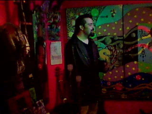 italian poet at the open mic at the Cabaret Culture Rapide in Paris&#8217; Belleville part of town.