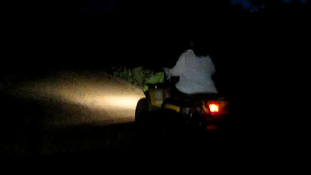 Driving-ATVs-at-night[www.savevid.com]