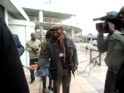 African Press International video: General Hussein Ali arrives at the ICC to face Ocampo