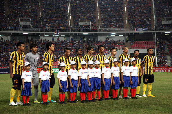 BANGKOK, THAILAND - 2014/12/17: Malaysia football team lune-up before the first leg match of the 2014 AFF Suzuki Cup final at Rajamangala National Stadium in Bangkok. Thailand defeats Malaysia 2-0 in their first leg 2014 AFF Suzuki Cup final match. The second leg will be played at Bukit Jalil National Stadium in Kuala Lumpur. (Photo by Piti A Sahakorn/LightRocket via Getty Images)