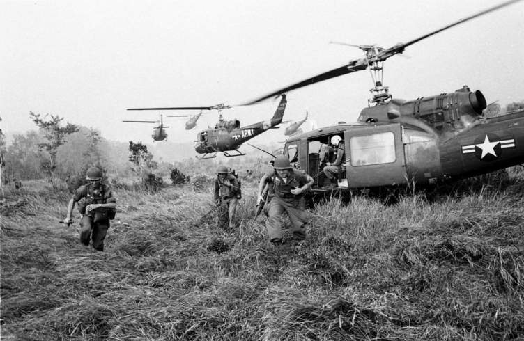 American soldiers are dropped off by U.S. Army helicopters during the Vietnam War. (Horst Faas/AP)