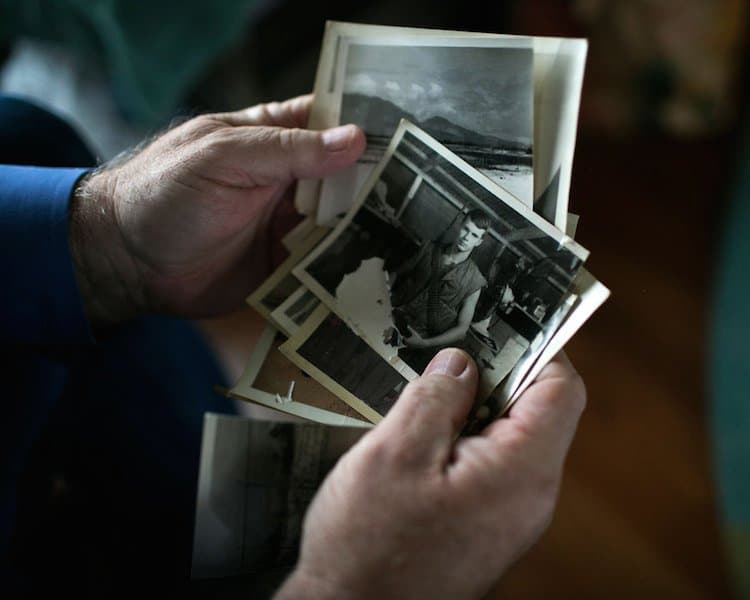 Mike Blackledge looks through photographs taken during his time in Vietnam. Blackledge believes his exposure to Agent Orange may have sickened his children born after the war. (Maddie McGarvey for ProPublica)