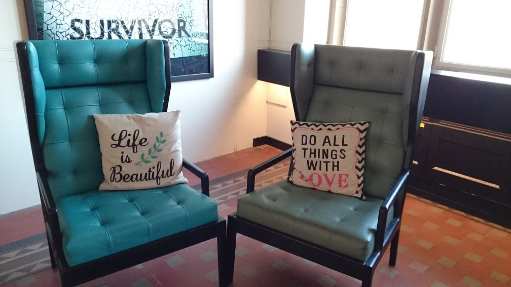 Two aqua wingback chairs  'life is beautiful' and 'do everything with love' cushion - survivor mosaic sign