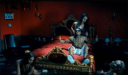 Here, Lil Wayne is in a bedroom that is full of water with women swimming in it. Aside from the fact that this water will probably cause a lot of damage to the room, it is another way to show slaves in uncomfortable settings and might be a way to subtly refer to water torture that MK slaves must go through. Also, notice the frame with butterflies in it - a way of reminding you that this is all about Monarch programming.