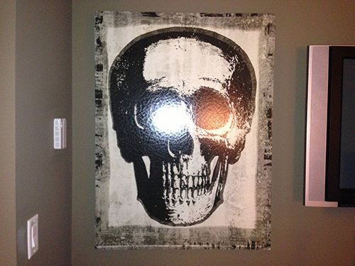 Skull frame on the wall. Rather appropriate since 322 is the Skull and Bones' sacred number.