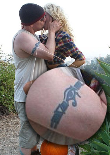 Here she is kissing with her 51 year-old husband - who appears to be her handler. The tattoo on his arm features the Eye of Horus and the alchemical symbols for fire and water (upright and reversed triangle) - which represents duality. That's the kind of symbolism a MK handler would sport.