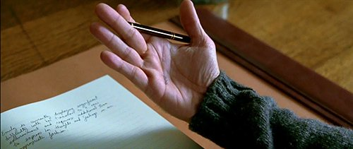 While in his study, David notices a black mark on his hand.