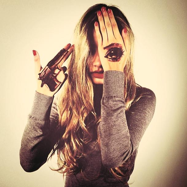Pia Mia used to work with Disney. Now she's doing the one eye thing and pointing a fake gun to her head. Considering Disney's relation with the MK-industry, makes perfect sense.