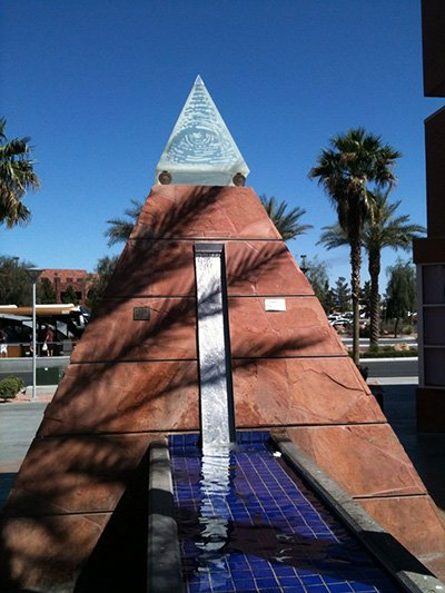 """The saying """"Symbols rule the world not words nor laws"""" means that you shouldn't listen to what """"officials"""" or media says about power. Just look at the symbolism and imagery that's around you. Here's a momunent in Las Vegas that's basically a tribute to Illuminati rule."""