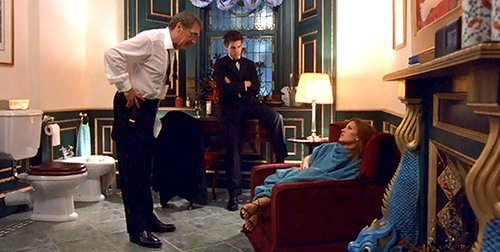 Bill finds Ziegler in his gigantic bathroom dressing up and an almost unconscious woman.