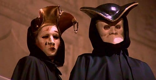 A couple wearing Venetian masks slowly turn towards Bill and nod in a very creepy matter. Is this Ziegler and his wife? This is never really clarified.