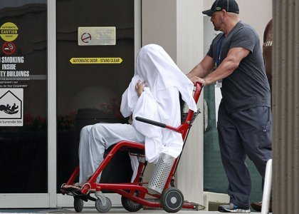 Bynes  wheeled between buildings at the Hillmont Psychiatric Center on July 25. Something is definitely not right here. Is she being re-programmed?