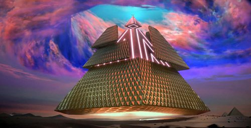 Katy-Patra receives a gigantic floating pyramid which hides, under a golden layer, an illuminated structure reminiscent of the Illuminati's high-tech control of the world.
