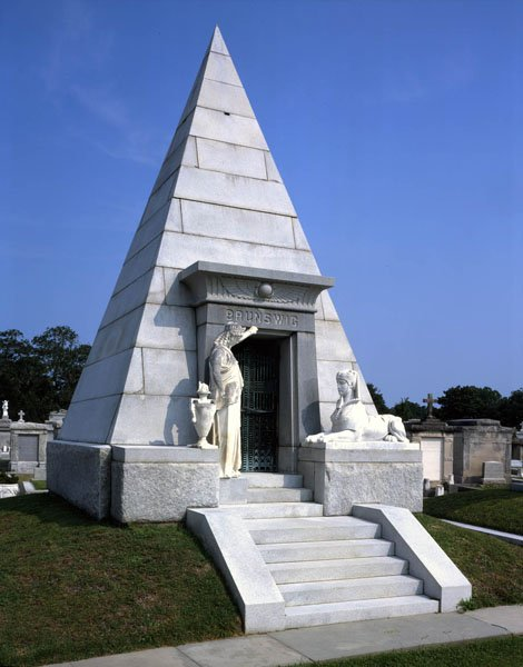 What these sites do not realize is that the Brunswig Mausoleum is the grave site of Lucien Napoleon Brunswig, a powerful figure in New Orleans. The Egyptian magic inspired mausoleum make it almost a certainty that Lucien Brunswig was part of an occult secret society - probably a high ranking Freemason. So Miley Cyrus' hand sign was far from random.