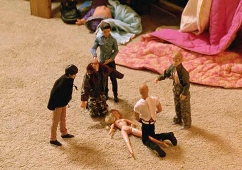 Martin Hart's daughter placed five male dolls around a female naked doll.