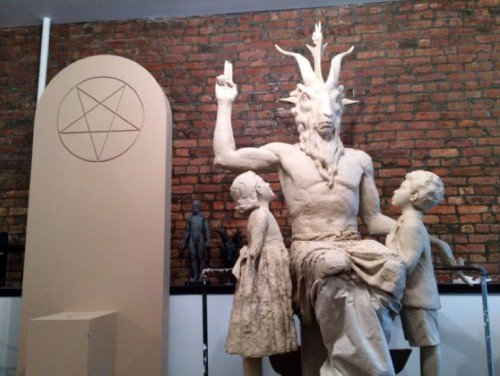 "Although the Temple of Satan claims that ""it does not believe in the supernatural"", its statue features Baphomet doing the hermetic hand sign ""as above so below"". It sits next to an inverted pentagram, the symbol of black magick."