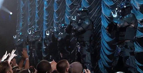 MJ is introduced by a bunch of police dressed in riot gear - a continuation of the police state agenda that prevails across the music business.