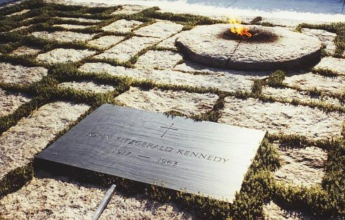 The tombstone of JFK is laid next to the Eternal Flame - symbol of the occult elite and its torch of Illumination.