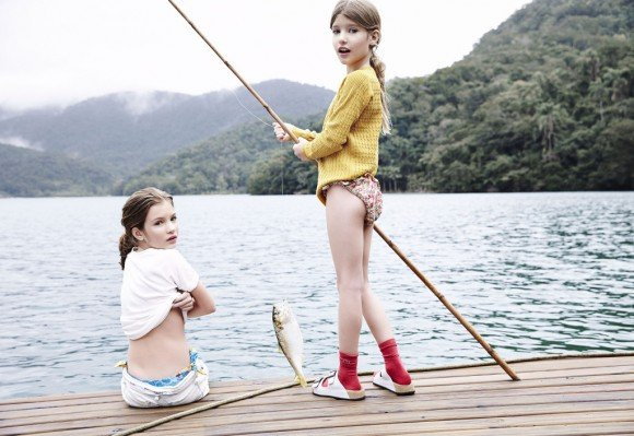 Another reason I hate the fashion world : The blatant and repeated sexualization of children. This photoshoot in Vogue Children Brazil features young girls in all kinds of suggestive positions and situations. Here's a pic of a girl undressing while catching some creep pervert taking a picture of them.