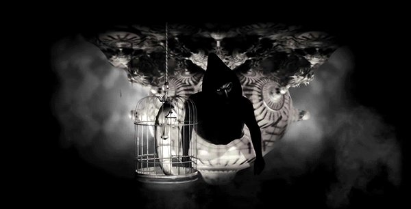 As Muse sings about the Handler, a bunch of symbols appear around him. A moon crescent inside a cage represent the sleepiness and the imprisonment of the MK slave.