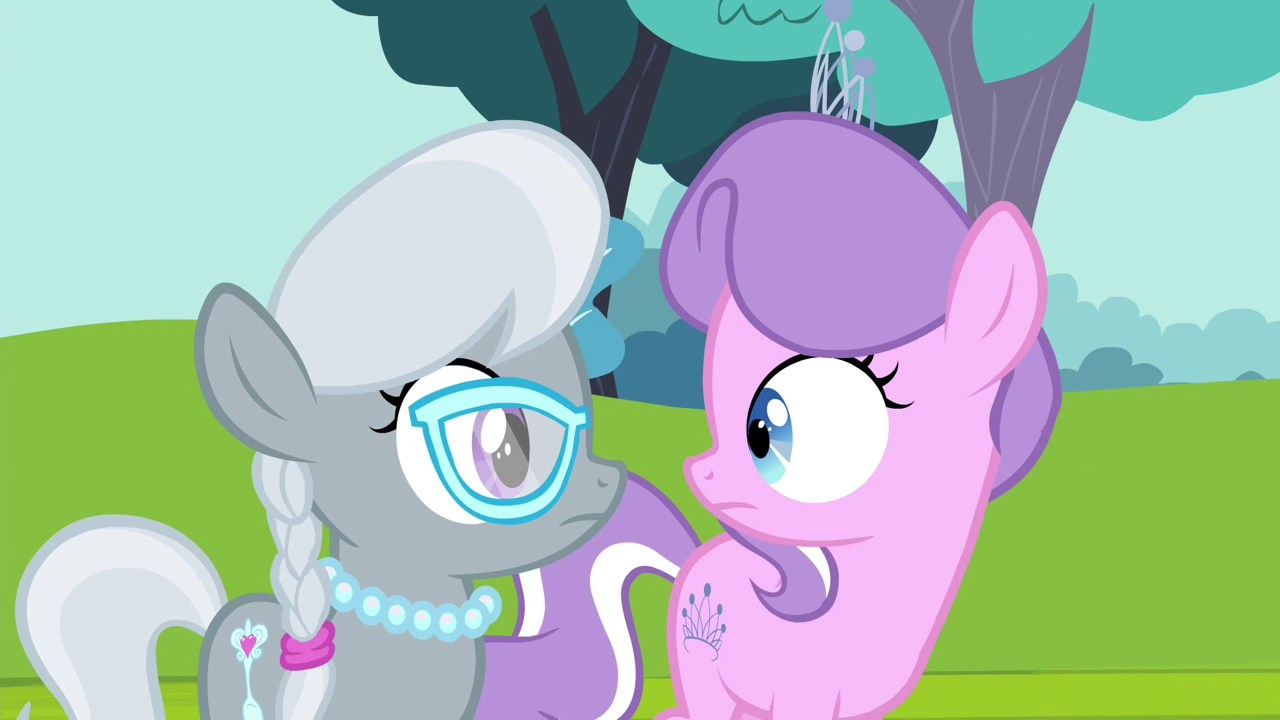 Image diamond tiara and silver spoon looking at each