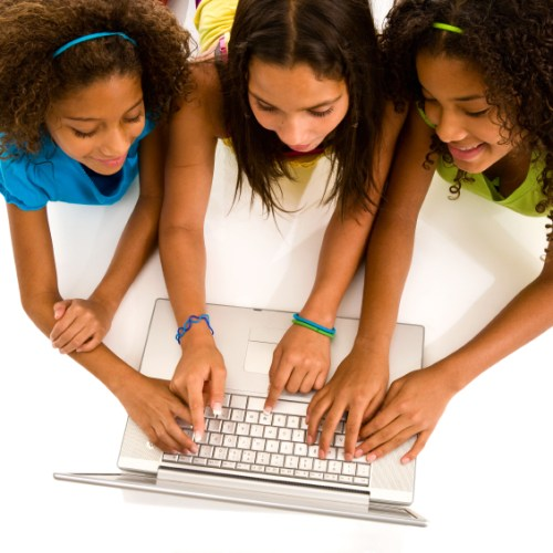 Three young girls on laptop