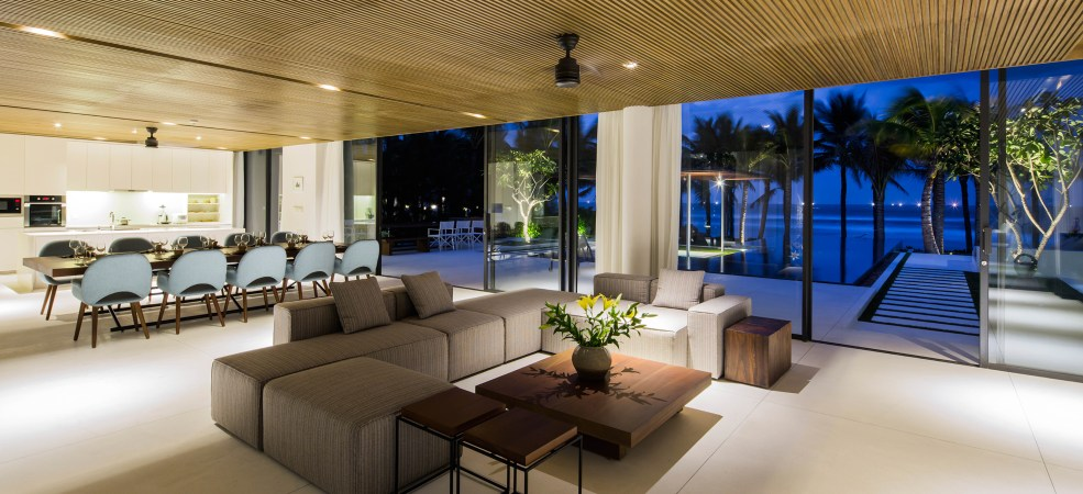Luxury open-plan living and dining area at dusk