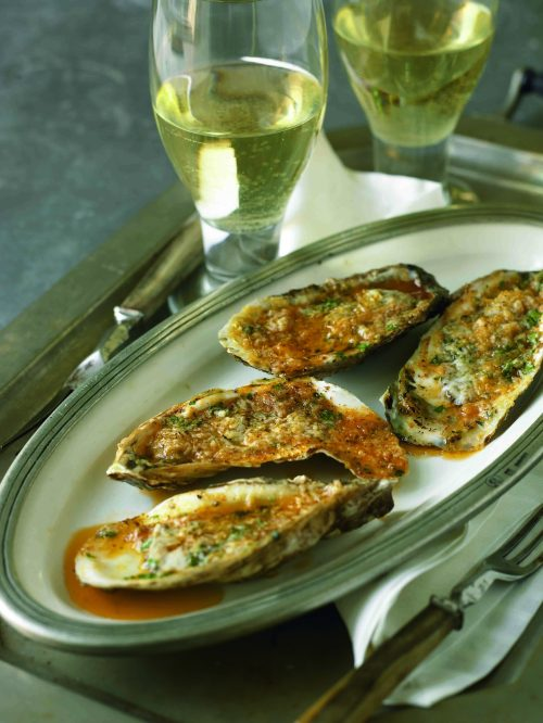 Fire it Up! Oysters Grilled with Roasted Garlic Butter and Romano