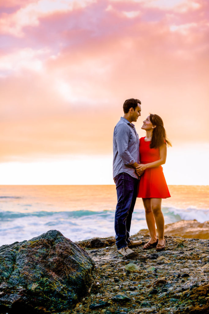 Couple portrait with a beautiful sunset at their Laguna Beach engagement session