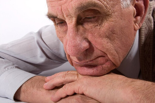 Portret of thoughtful serious old man