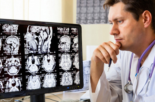 Doctor in hospital looking at ct scan