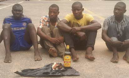 DEALERS: Fatai Akinwowo, herbalist (left) and alleged suppliers of human parts. On the ground are suspected mixture of ground human head and local gin in a bottle alongside a human finger, allegedly recovered from the suspects.