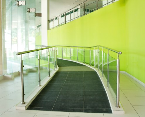 Lower floor view of wheelchair ramp facility in a building for aiding people with special needs