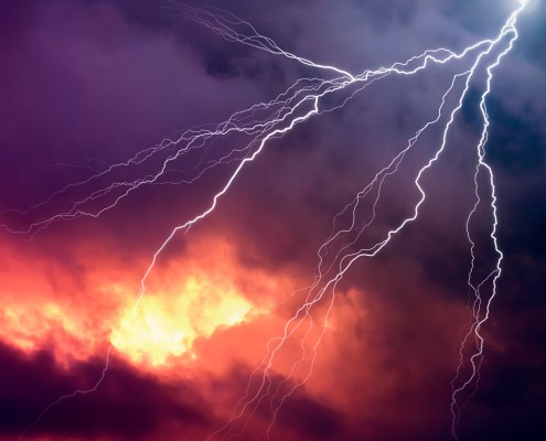 Lightning in front of a dramatic background - computer generated image