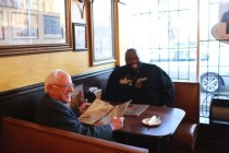 Presidential hopeful Bernie Sanders and Rapper Killer Mike share a meal. Photo by Hilary Hess