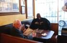 Presidential hopeful Bernie Sanders and Rapper Killer Mike share a meal. Photo by Hilary Hess