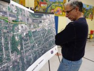 Burlington resident Andy Simon takes in the design plan for the Champlain Parkway. Photo by Morgan True / VTDigger.