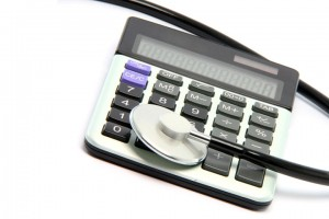 StockXchng image of stethoscope and calculator.
