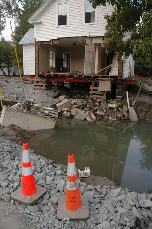 The White River jumped its banks in West Hartford and tore off the front of this house and swept away its foundation. VTD/Andrew Nemethy
