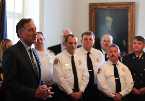 Gov. Peter Shumlin with emergency workers at a signing of S.106, the search and rescue bill. Photo by Alan Panebaker