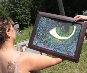 Ariana Davidonis displays a painting by Macadam Mason at her home in Thetford, where Mason was tased Wednesday. VTD Photo/Taylor Dobbs