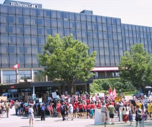 Protesters converge on the Hilton Hotel in Burlington. Photo by Greg Guma