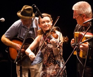 The sensation of the 2011 New World Festival was the 17-year-old fiddler for the John Whelan Band, Kathleen Parks. Kathleen was playing only her second gig with the band, which is fronted by accordionist Whelan and guitarist Flyn Cohen. (Photo by Tim Calabro, courtesy of Herald of Randolph)
