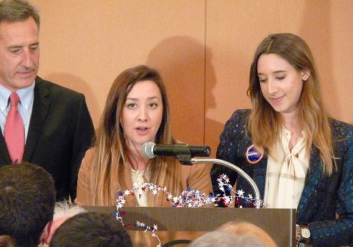 Gov. Peter Shumlin's daughters, Olivia, center, and Becca, right, introduce their father to supporters on election night. Photo by Anne Galloway